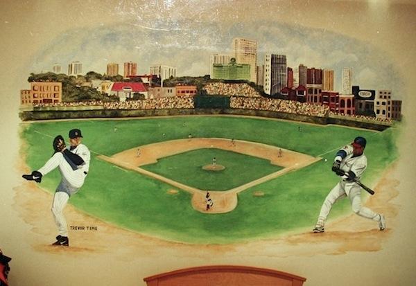 vintage boys baseball theme room with baseball field mural