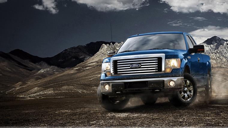 2012 Ford F 150 in Blue Near Mountains Wallpaper