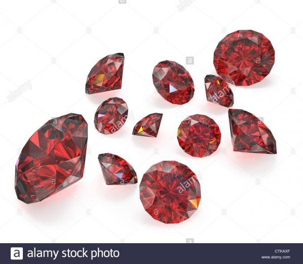 Few round cut rubies isolated on white background Stock Photo