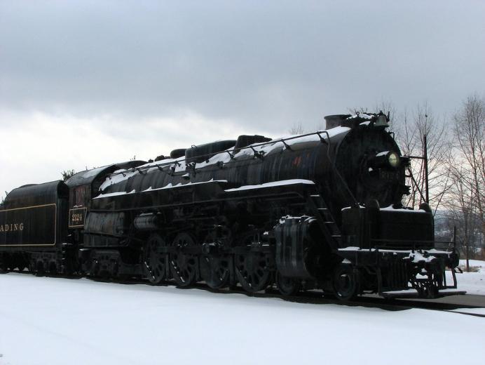 Train Stock Photo A steam locomotive under a stormy winter