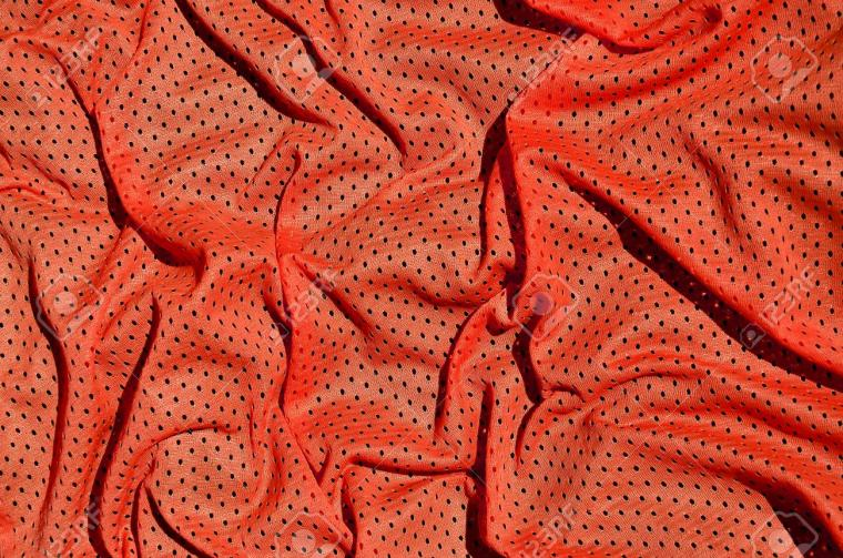 Sport Clothing Fabric Texture Background Top View Of Red