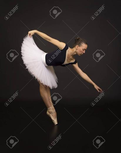 Gorgeous Ballerina In A White Tutu Dancing Ballet Studio Shooting