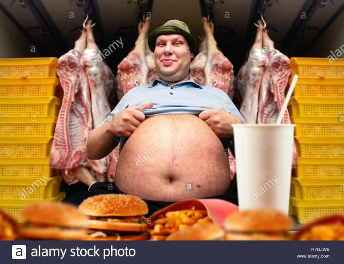 Happy fat man and fast food pork carcasses on background