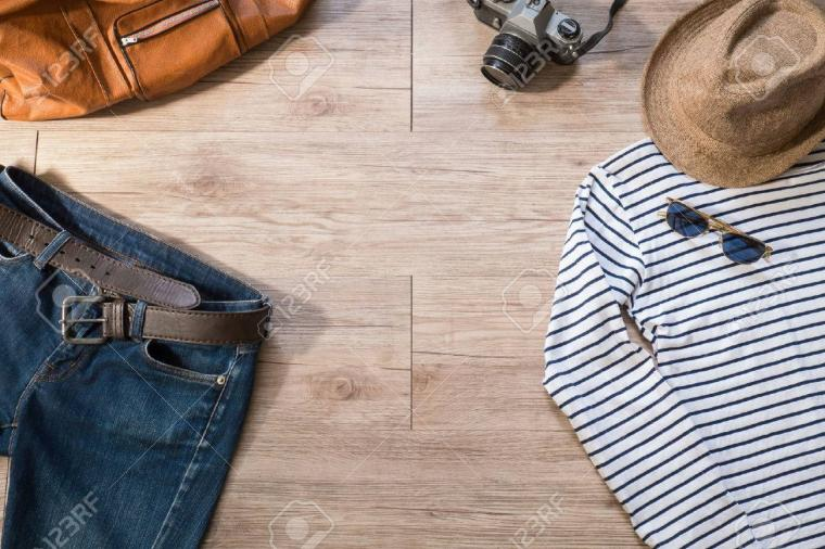 Top View Of Vintage Clothing And Accessories On The Wooden
