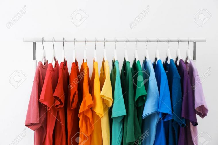 Rack With Bright Clothes On White Background Rainbow Colors Stock
