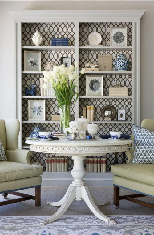 Line back of bookcases or shelves with fabric or wallpaper