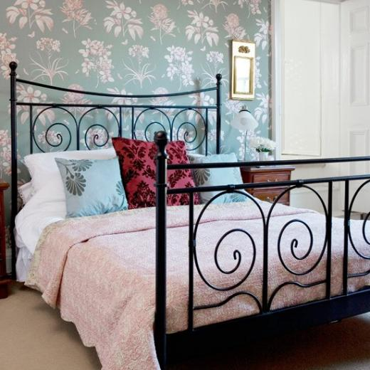 Hang a feature wallpaper Glamorous bedroom decorating ideas