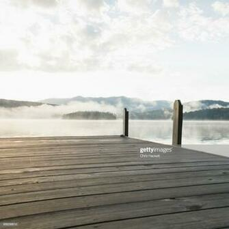 Usa New York Lake Placid Pier With Foggy Lake In Background Stock
