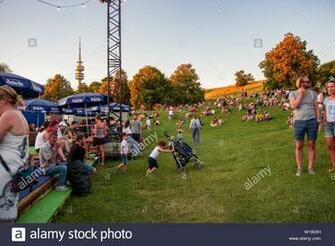 People watch the sunset at the festival ground with the Olympia