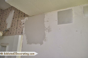 to fix a hole in drywall   the easy way   using a drywall repair patch