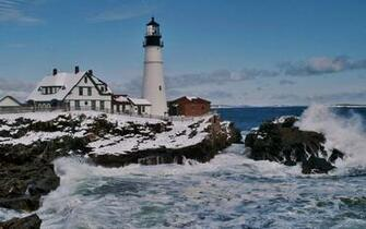 Lighthouse on a rough seashore in winter   163879   High Quality