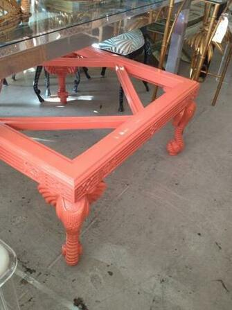 This fretworkelephant coffee table will not last Itis lacquered in a