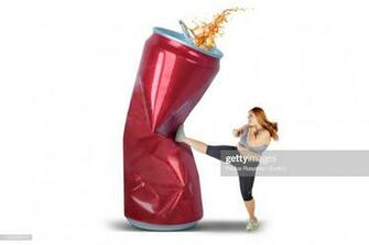 Overweight Woman Kicking Drink Can Over White Background Stock