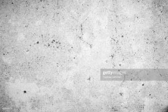Weathered And Aged Concrete Wall Texture Background In Black And