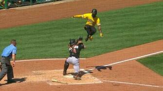 Andrew McCutchen tries hurdling catcher JT Realmuto at home