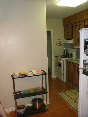 After we removed the wallpaper and painted this kitchen For a