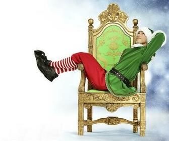 Wallpapers Elves New year Young man Legs Uniform Sitting Armchair