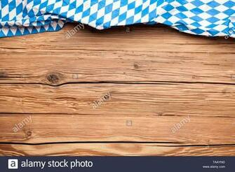 Oktoberfest tablecloth on an old rustic wooden background Stock