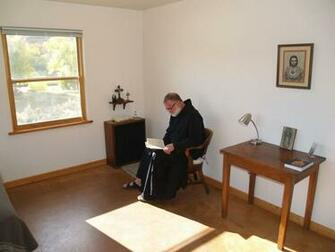 A brother doing Lectio Divina in his cell   Benedictine Abbey of