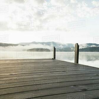 USA New York Lake Placid Pier with foggy lake in background