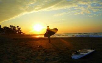 Girl Surfer At Sunset