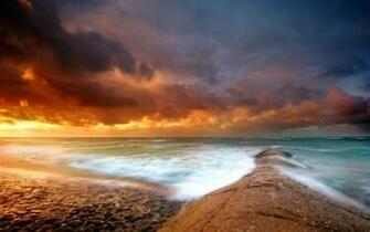storm wet cliffs pebbles cloud 1920x1200 wallpaper Waves Wallpaper