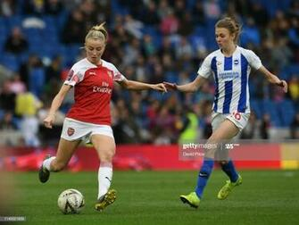Leah Williamson of Arsenal is closed down by Ellie Brazil of