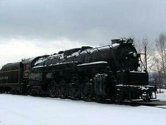 Train Stock Photo A steam locomotive under a stormy winter
