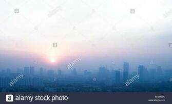 Pollution concepts with smog on city landscape in morning health