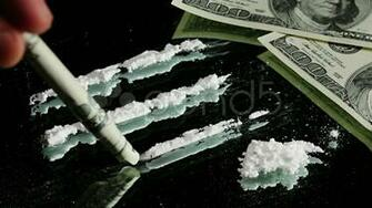 Cocaine Snorted Through Rolled 100 Dollar Banknote Stock Video