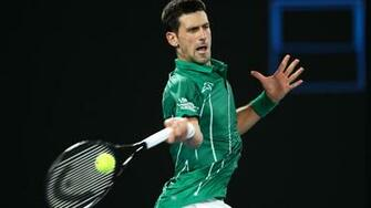 Australian Open 2020 Novak Djokovic overcomes wobble to progress