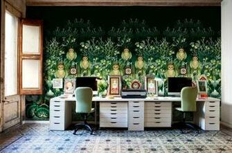 Elaborate and exquisite wallpaper creates a colorful home office