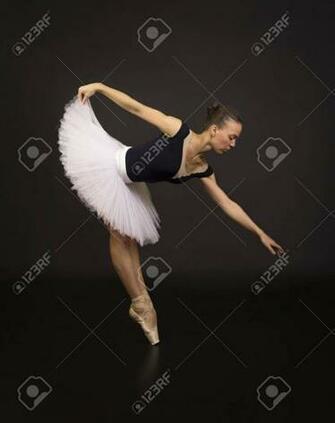 Gorgeous Ballerina In A White Tutu Dancing Ballet Studio Shooting