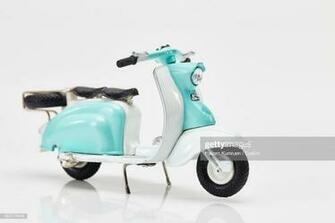 Turquoise Toy Scooter Against White Background Stock Photo   Getty