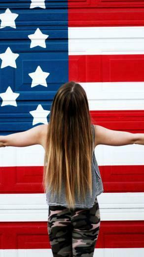 American Girl In Front Of USA Flag United States of America