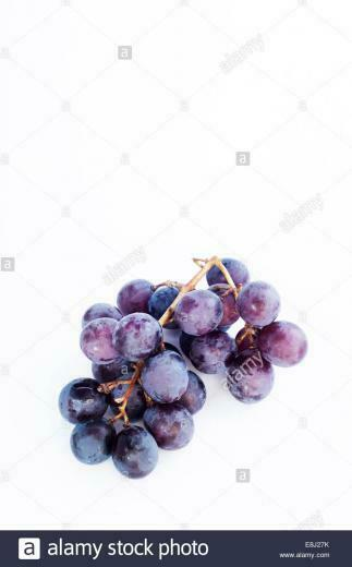 Red Japanese Black Olympia grapes isolated on a white background