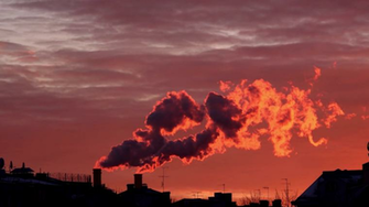 The smoke from the chimney on the sunset Air pollution background