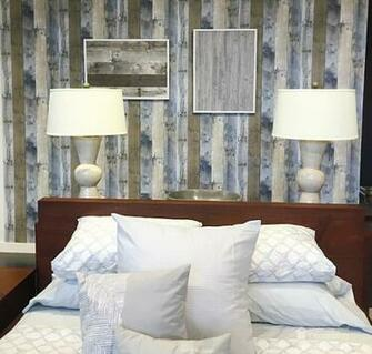 amazing how real this faux repurposed wood adhesive wallpaper looks
