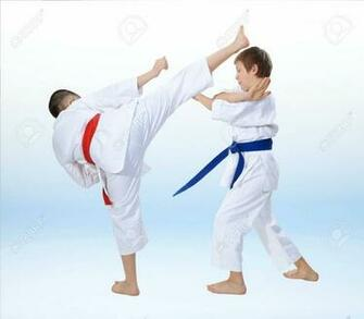 Children Are Training Karate Techniques On A Light Background