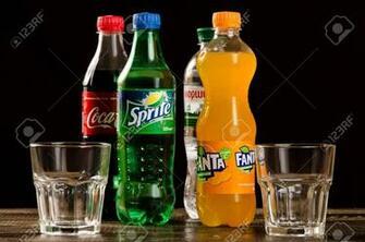 Coca Cola Fanta Sprite With Glasses On A Dark Background Stock