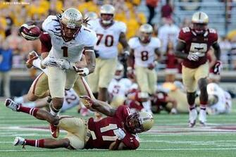 Florida State Seminoles wide receiver Kelvin Benjamin leaps over