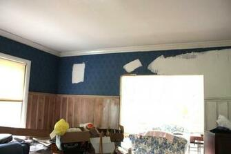 white area is drywall mud than had been applied over the wallpaper