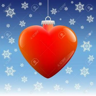 Heart Shaped Christmas Ball Hanging Against A Placid Winter