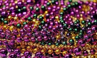 Background Of Mardi Gras Beads With Shallow DOF Stock Photo