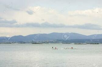 Canoeing On Arousa Estuary With Mussel Aquaculture Rafts At