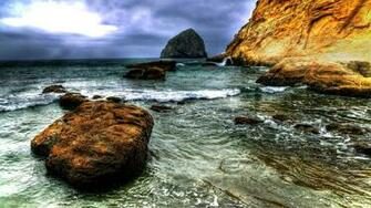 Download wallpaper 1366x768 stone water sea silt sky tablet