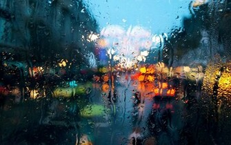 colourful rainy drops on window wallpaper   View All