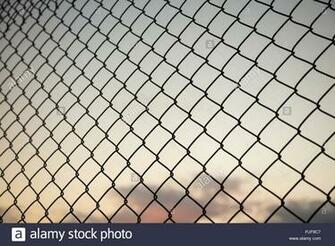 Sky through wire mesh fence Blur background close up view of
