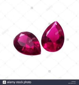 Pear Shape Diamond Cut Rubies on a White Background Stock Photo