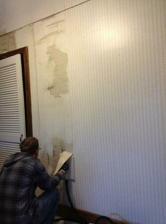 steaming wallpaper on the kitchen wall it was adhered to raw drywall